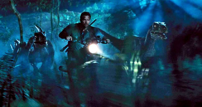 Owen (Chris Pratt) riding as the alpha velociraptor in his