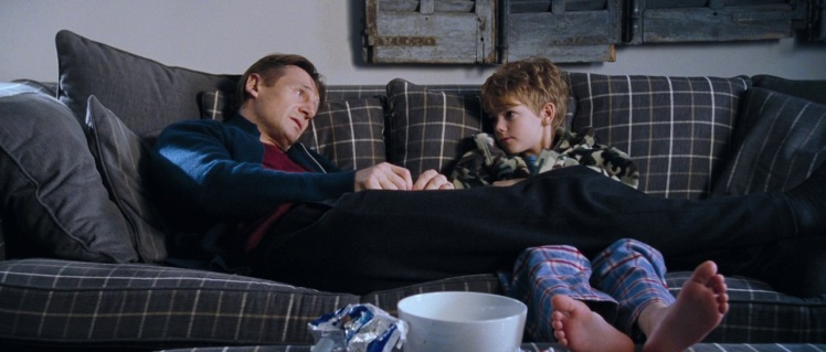 It's hard not to feel warm fuzzies seeing Liam Neeson get all emotional with an eleven-year-old.